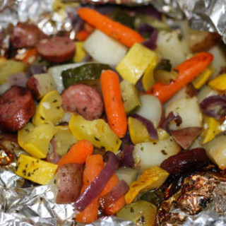 Are you looking for a quick fun new recipe that will get your family to eat their veggies? These Grilled Sausage and Veggie Packs are a favorite around our house and the best news? No pots and pans to clean up!