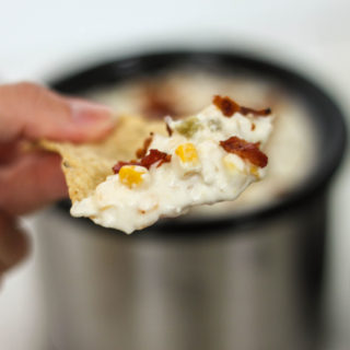 Great crock pot dip recipe with corn and bacon! Perfect for tailgating or to make while watching the big game.