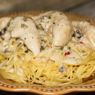 This Angel Chicken is an easy crockpot chicken recipe that the whole family will love! Serve the chicken over pasta. One of my favorite slow cooker recipes!