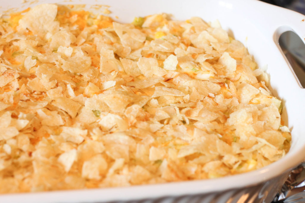 This Hot Chicken Salad recipe is topped with potato chips and is a casserole the whole family will love!