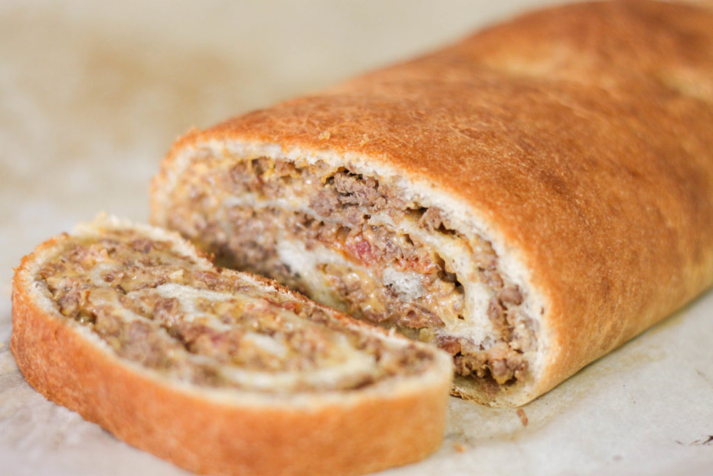 This Bacon Cheeseburger Roll-Up is the perfect twist on a classic burger recipe. Bacon Cheeseburer Roll-Ups make a great appetizer recipe but are also filling enough to make a fun dinner.