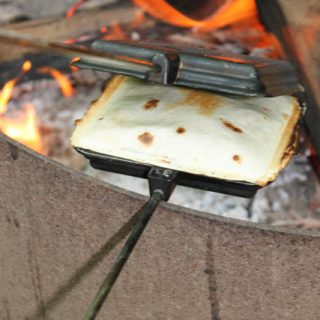 Are you looking for a new, easy, make ahead recipe to make during your next camping trip? This Pie Iron Tasty Taco recipe is great over the campfire.