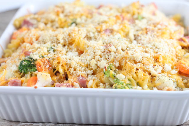This Cheesy Ham & Vegetable Bake is a quick and easy casserole recipe packed with pasta, ham, broccoli, carrots and cauliflower in a cheesy cream sauce.