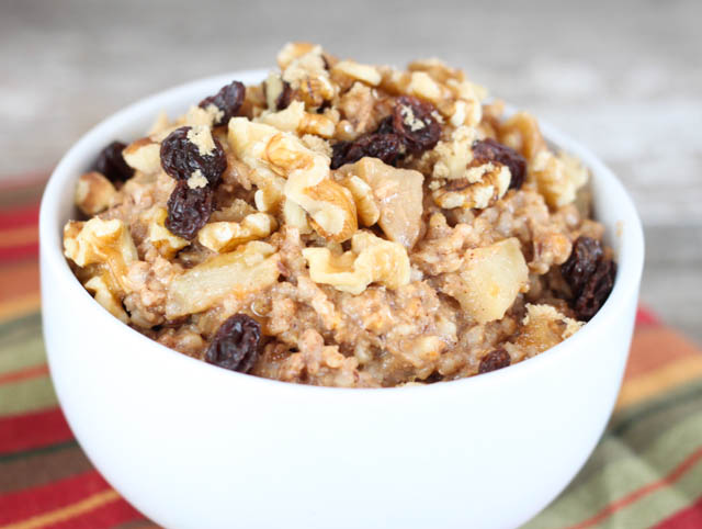 This Apple Pie Oatmeal recipe is made with steep cut oats overnight in the slow cooker so you can wake to a healthy breakfast!