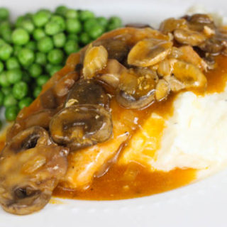 Are you looking for an easy slow cooker pork chop recipe? Then you must try these Crock Pot Pork Chops with Golden Mushroom Gravy!
