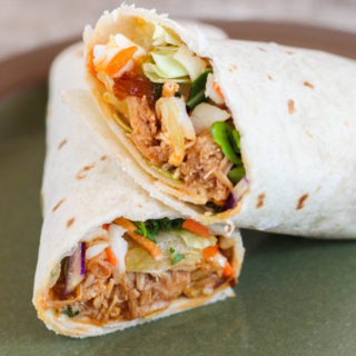 These homemade Asian Chicken Wraps are so good and use rotisserie chicken and bagged salad mix making them easy to toss together for lunch.
