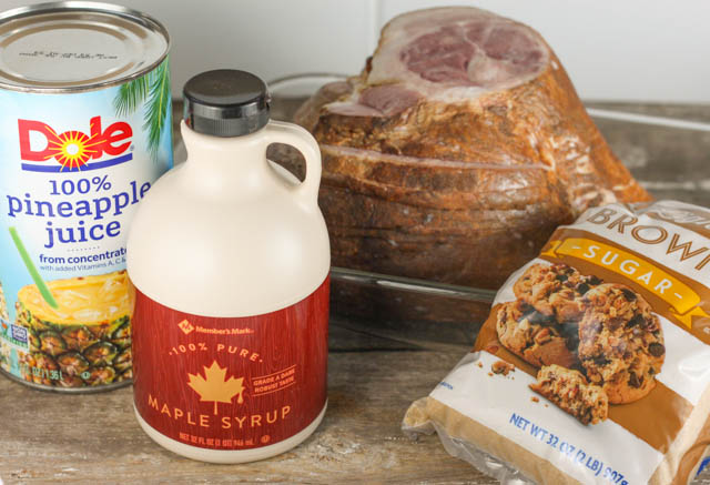 This Slow Cooker Holiday Brown Sugar Ham has all your favorite traditional flavors including pineapple and maple syrup and will be a hit at your next Holiday!