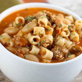 Mommy's Pasta Fagioli is a pasta and bean soup that includes sausage and is hearty enough to be served as an easy meal.