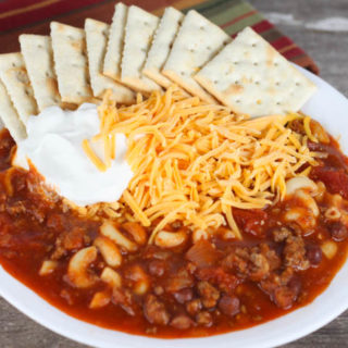 This Easy Chili Mac is a one pot meal that the whole family will love, that is made with ground beef, chili beans, macaroni and topped with cheese!