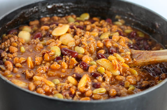Calico Baked Beans with hamburger and bacon is the perfect recipe for a crowd. It is a must at all of our family gatherings!