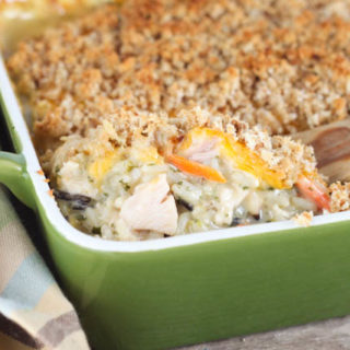 Chicken and Rice Casserole is an easy comfort food recipe everyone loves, including picky eaters! Made with rice, chicken, cream of chicken and vegetables and topped with cheese and bread crumbs!