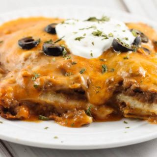 Crock Pot Ground Beef Enchilada Casserole is an easy layered Mexican dish the whole family will love!