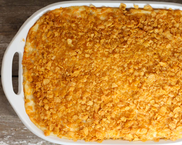 Cheese Potato Casserole is a family favorite at our house! A yummy potato side dish that is topped with cornflakes.